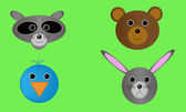Four forest wildlife animal heads including raccoon bluebird brown bear and rabbit All elements are separate