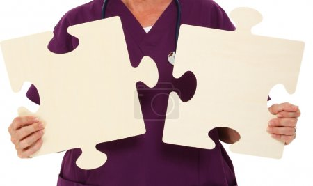 Physician Holding Puzzle Pieces