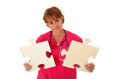 Nurse Holding Puzzle Pieces