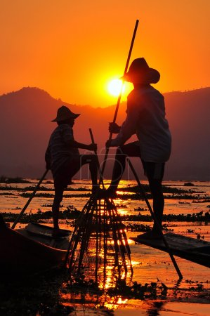 Fishermen in Inle lakes sunset.