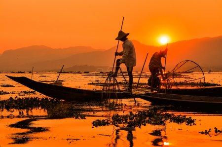 Fishermen in Inle lakes sunset, Myanmar