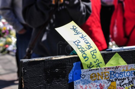 BOSTON CITY - APR 30: Makeshift Memorial for Marathon bombing victims at Copley Square, Boston, Massachusetts on April 30, 2013. Hundreds of people lay flowers, display messages of hope for 4 victims.