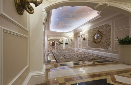 Classic wide corridor with marble floor and carpet