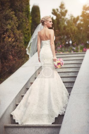 Bride in wedding day with bouquet