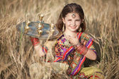 Indian girl with traditional plate