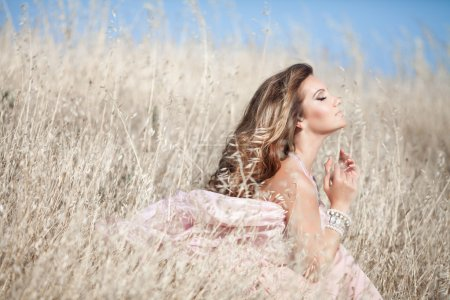 Photo for Beautiful sexy woman in field Outdoor portrait. Delicate sensual woman on nature. Perfect skin, curly hair, sexy body - Royalty Free Image