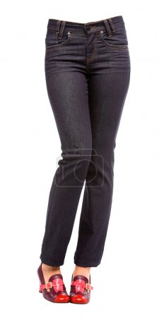 Young woman bent legs in black jeans and purple pumps