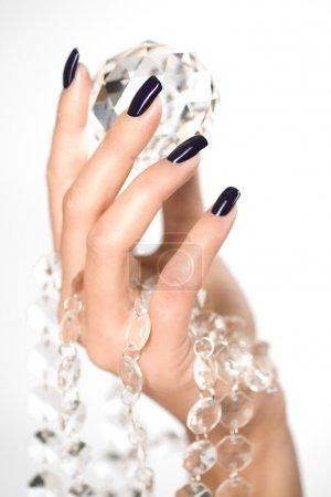 Beautiful woman hands with big diamond