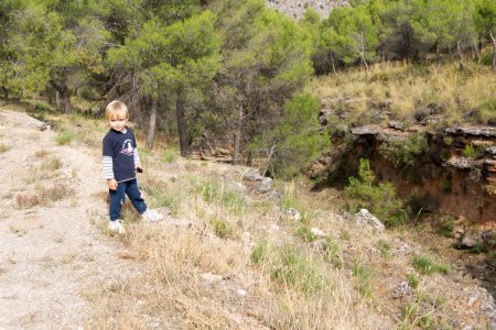 Little boy near the ravine