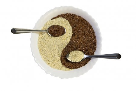 Eastern cuisine - sesame seeds in yin yang shape plate, isolated