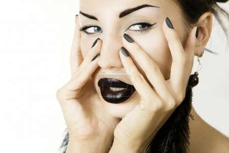 Beautiful girl with black lipstick matte black manicure and acce
