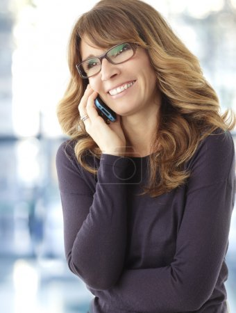 Mature woman talking on phone