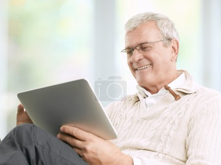 Photo for Senior businessman working at home with his digital tablet - Royalty Free Image