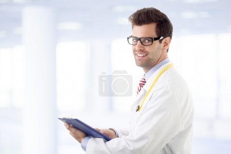 Male doctor examining medical report