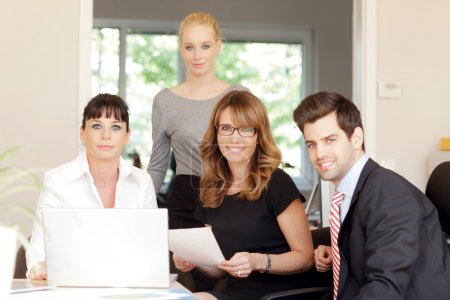 Photo for Portrait of friendly professional business team smiling at the camera - Royalty Free Image