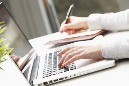 Photo for Close-up of busineswoman's hands doing paperwork. - Royalty Free Image