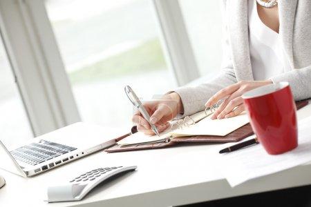 Businesswoman making list