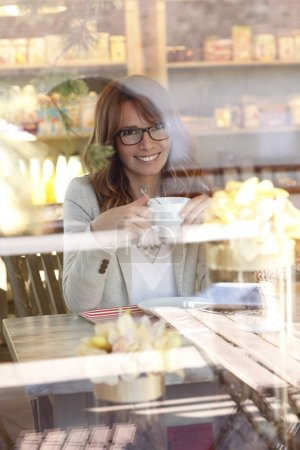 Mature woman in coffee shop