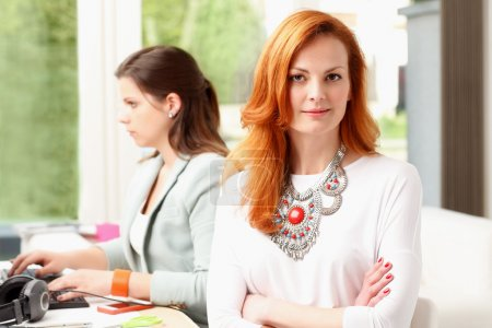 Woman working with colleagues