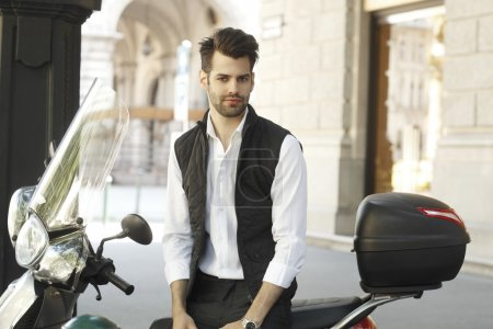 Modern businessman with scooter