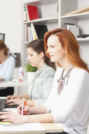 Teamwork at modern graphic design studio