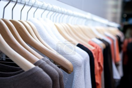Photo for Clothes hang on a shelf in a designer clothes store in Melbourne, Australia - Royalty Free Image