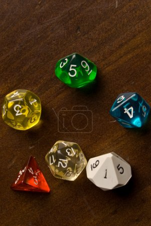 Multicolored Role Play Dice on a wooden table top