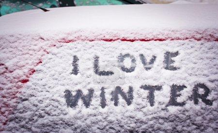I love winter written in snow on car window