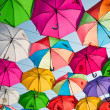 Colorful umbrellas in the sky on a bright summer d...