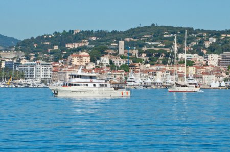 Beautiful yachts on a sparkling blue sea in Cannes, France