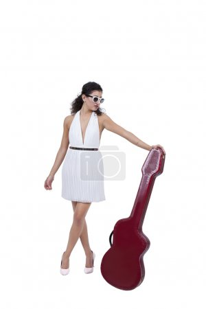 Female wearing sunglasses posing with guitar