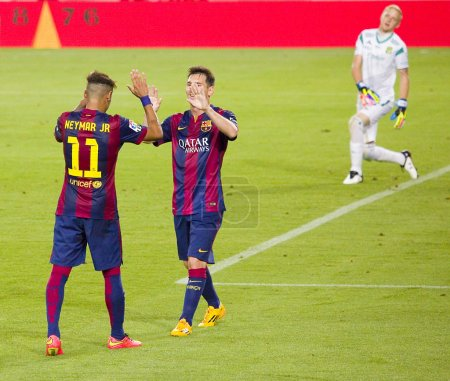 Neymar and Messi celebrating a