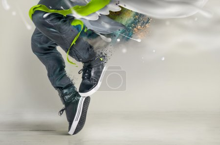 Photo for Modern dance in jeans and sneakers with splashes, splatters - Royalty Free Image