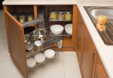 Detail of open kitchen cabinet with cans of beans...