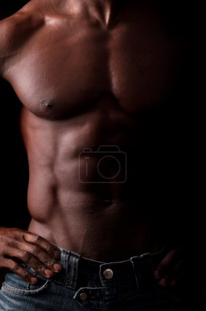 Photo for Beautiful and muscular black man in dark background - Royalty Free Image