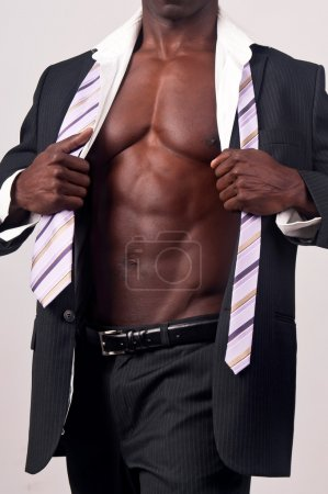 Photo for Young black man with muscular body and suit - Royalty Free Image