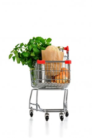 Photo for Shopping cart full with groceries isolated in white - Royalty Free Image