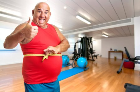Photo for Large fitness man with measuring tape - Royalty Free Image