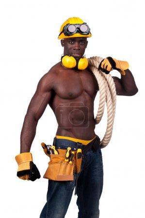 Photo pour Forte construction ouvrier noir avec une corde isolée en blanc - image libre de droit