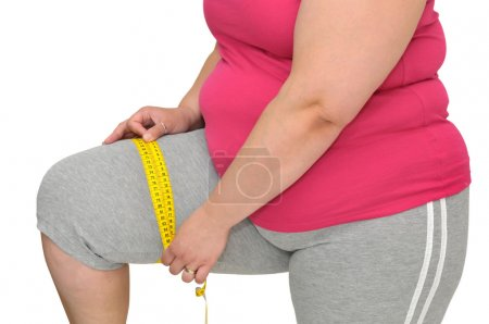 Photo for Body part of a fat woman with measuring tape - Royalty Free Image
