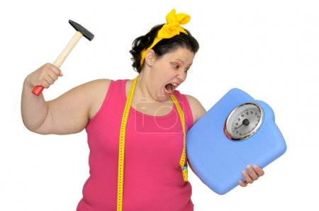 Photo for Angry large girl with hammer and scale isolated in white - Royalty Free Image