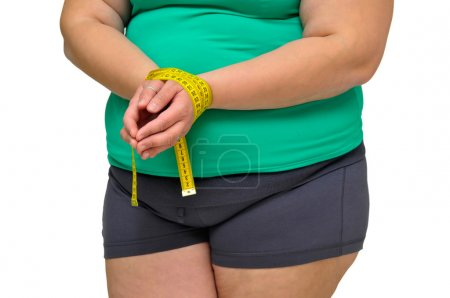 Photo for Large girl body part with measuring tape isolated in white - Royalty Free Image