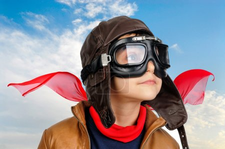 Photo for Young boy pilot against a blue cloudy sky - Royalty Free Image