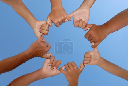 Photo for Hands together against the sky - Royalty Free Image