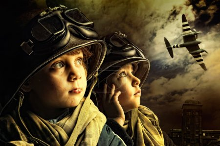 Photo for Two young boy soldiers looking at the skies - Royalty Free Image