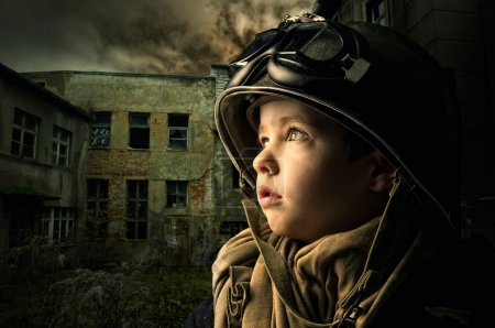 Photo for Young boy alone in a war zone - Royalty Free Image