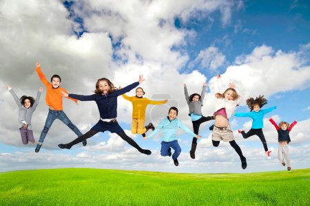 Photo for Group of children jumpng outdoors - Royalty Free Image