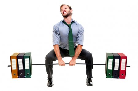 Photo for Muscular businessman lifting weights made of heavy files - Royalty Free Image