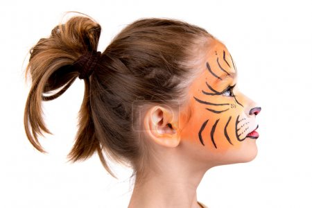 Photo for Beautiful young girl with face painted like a tiger - Royalty Free Image