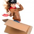 Young girl pilot flying a cardboard box isolated i...